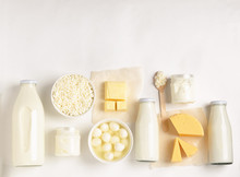 Dairy And Fermented Milk Fermented Organic Products On A White Background. Milk Kefir Yogurt Butter Cheese Assortment.