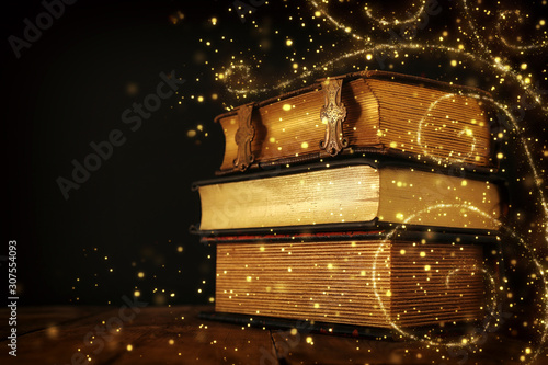 Photo stack of antique books on old wooden table