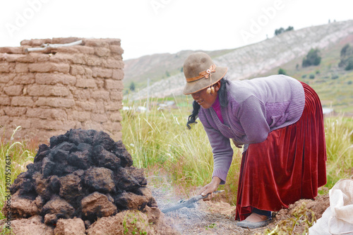 Native american woman cooking in the huatia - traditional eathern oven Wallpaper Mural