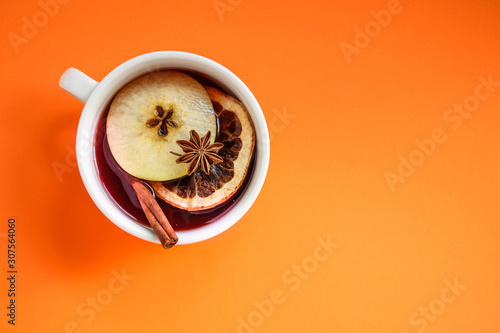 Recess Fitting Tea Christmas mulled wine on a wooden table. Traditional hot drink at Christmas (red wine with spices, New Year's Eve, Noel holiday festive) x-mas flat lay. food background. copy space. Top viev
