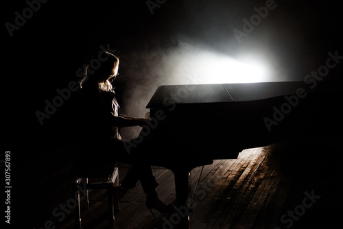 Pianist musician piano music playing. Musical instrument grand piano with woman performer - 307567893