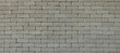 Rustic gray grunge brick wall texture background.