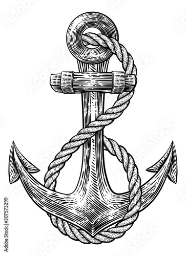 Photo An anchor from a boat or ship with a rope wrapped around it tattoo or retro styl