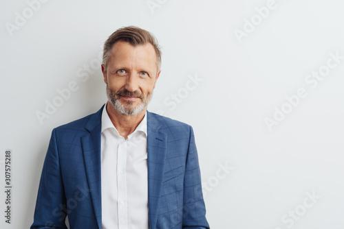 Obraz Middle-aged man in blue blazer, copy space - fototapety do salonu