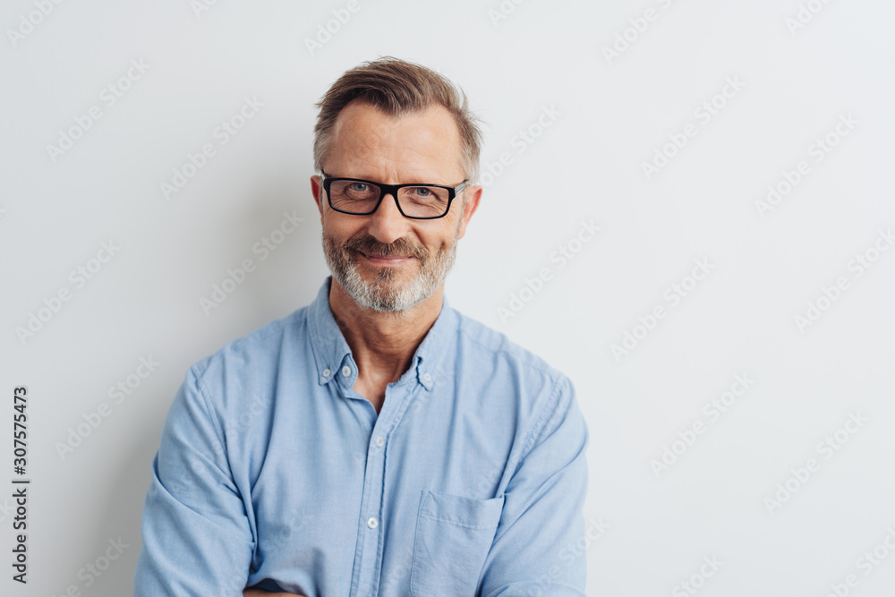 Fototapeta Bearded middle-aged man wearing glasses