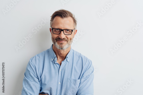Obraz Bearded middle-aged man wearing glasses - fototapety do salonu