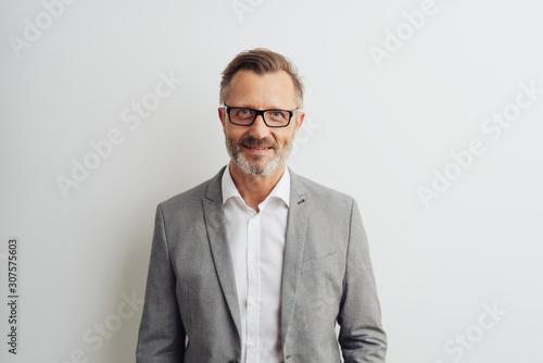 obraz dibond Middle-aged businessman wearing glasses