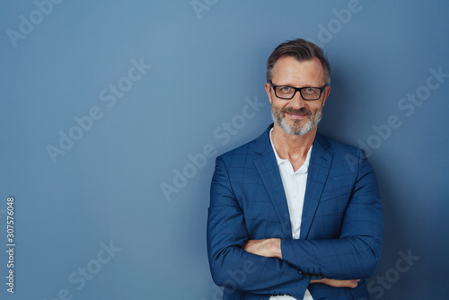 Fototapeta Self-assured attractive middle-aged man obraz