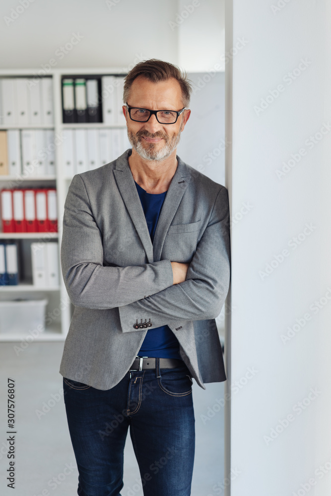 Fototapeta Relaxed stylish businessman smiling at camera
