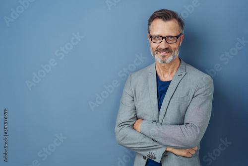 Fototapeta Friendly confident professional man on blue obraz