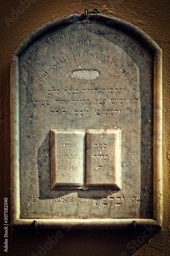 Photo Stone with text on the wall of Synagogue in Rome