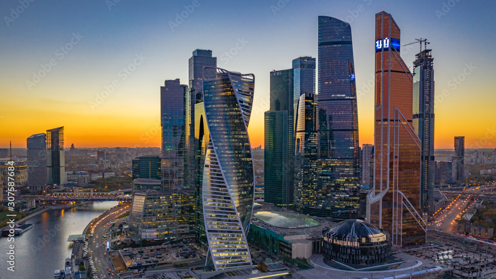 Fototapeta Moscow city skyline and skyscraper building construction architecture aerial view, Moscow International Business and Financial Center at sunset with Moscow river, Russia.