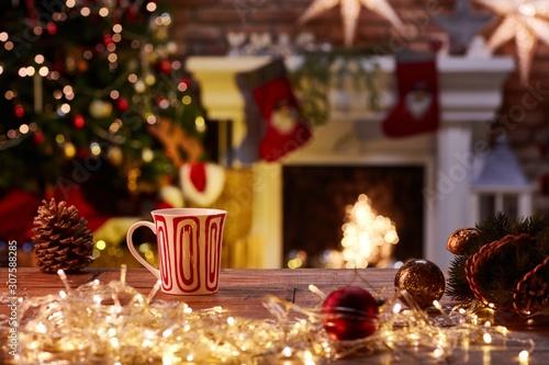 Fototapeta Christmas still life with mug and fireplace obraz