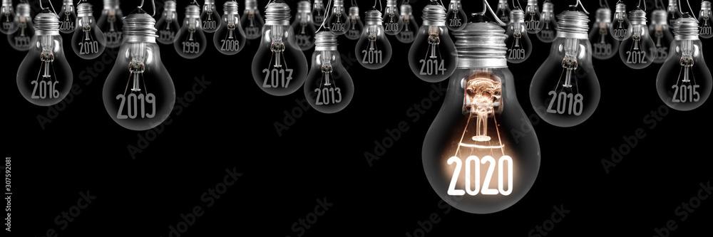 Fototapeta Light Bulbs with New Year 2020