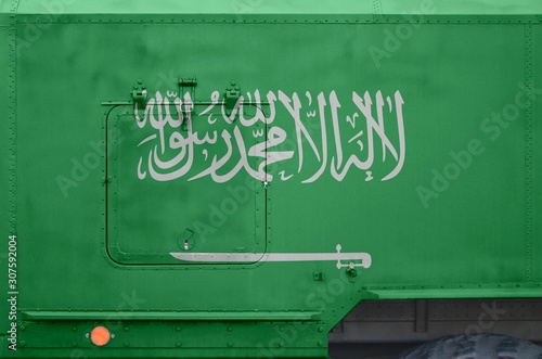 Saudi Arabia flag depicted on side part of military armored truck closeup Canvas Print