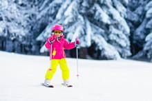 Ski And Snow Fun. Child In Win...