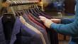 Man choosing wear at clothing store