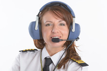 Woman Airline Pilot With Headset