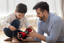 Father Helps To Little Son Rep...
