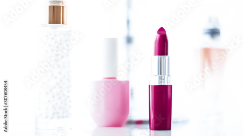 Fotografia Cosmetics, makeup products on dressing vanity table, lipstick, foundation base,