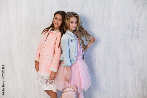 Portrait of two beautiful fashionable girl girlfriends in white pink clothes Canvas Print