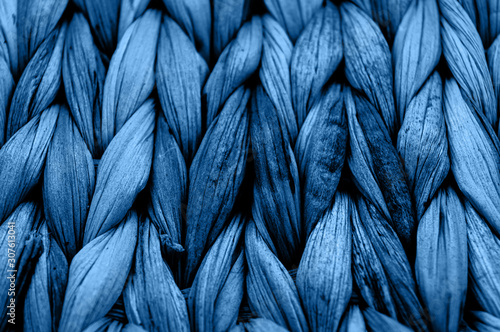 Rustic natural wicker texture toned in classic blue monochrome color. Braided pattern macro photography. - 307613041