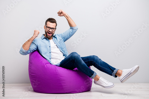 Fotografía Full size photo of crazy guy watch tv sitting comfortable soft violet armchair c