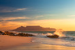 canvas print picture - scenic view of table mountain cape town south africa from blouberg at golden sunset with splashing waves