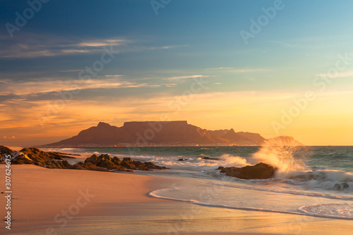 Fototapeta scenic view of table mountain cape town south africa from blouberg at golden sun