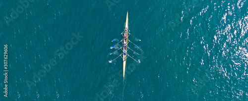 Aerial drone top panoramic view of sport canoe rowing synchronous athletes compe Wallpaper Mural