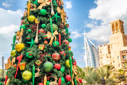 DUBAI, UAE - DECEMBER 9, 2016: Dubai Madinat Jumeirah Christmas Tree and Burj Al Wallpaper Mural