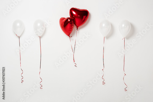 shiny and red party balloons on white