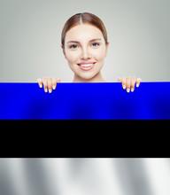 Estonia Concept. Happy Cute Girl Showing Estonian Flag Backgroun