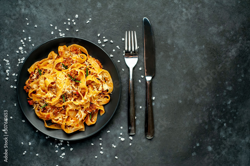 Pasta Bolognese with spices, Italian pasta dish with minced meat and tomatoes in Canvas Print