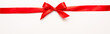 canvas print picture - panoramic shot of red ribbon with bow on white