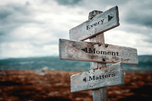 Every Moment Matters Text On Wooden Rustic Signpost Outdoors In Nature/mountain Scenery. Time Is Precious Concept.