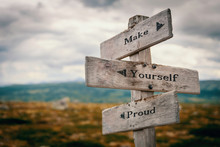 Make Yourself Proud Text Quote On Wooden Rustic Signpost Outdoors In Nature/mountain Scenery. Goals, Future And Achievement Concept.