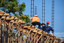 Hua Hin, Thailand.  Construction Workers Work In The Heat.