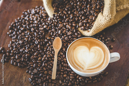 Wall Murals Cafe coffee latte with coffee beans on dark background, top view