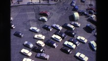 LOUDES FRANCE-1969: Summer Traffic Downtown Near City Park 1960 Chaotic Scramble