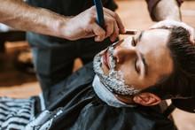 Barber Shaving Bearded Man Wit...