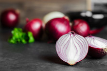 Cut Red Onion On Dark Background. Selective Focus. Copy Space