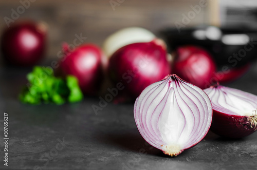 Cut red onion on dark background. Selective focus. Copy space Canvas Print