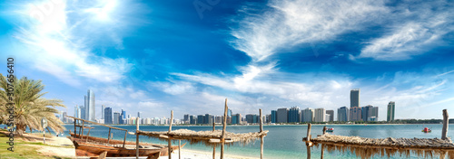 Panoramic view of Abu Dhabi Downtown skyline from the beach at sunset, UAE Wallpaper Mural