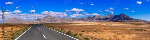 Impressive landscape and deserted roads of volcanic Fuerteventura , Canary islands - 307669241