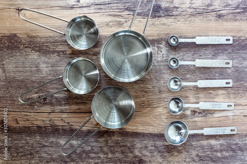 Valokuvatapetti Set of measuring cups and measuring spoon with a handle made from stainless on w