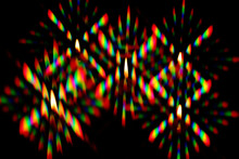 Flame Of A Candles Surrounded By A Halo Of Multi-colored Glares, Was Photographed Through Two Crossed Diffraction Gratings. Diffraction Pattern Of Light From A Candle, Including Several Orders