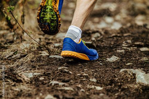 obraz PCV closeup legs running shoes athlete run uphill on muddy trail