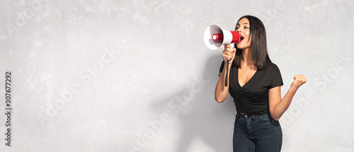 Cuadros en Lienzo Beautiful Brunette Woman Shouting Through Megaphone