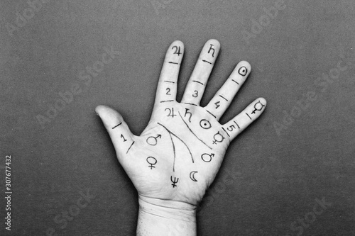Person's left palm with drawn lines and chiromancy symbols Wallpaper Mural